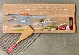 käsitsi maalitud puidust lõikelaud